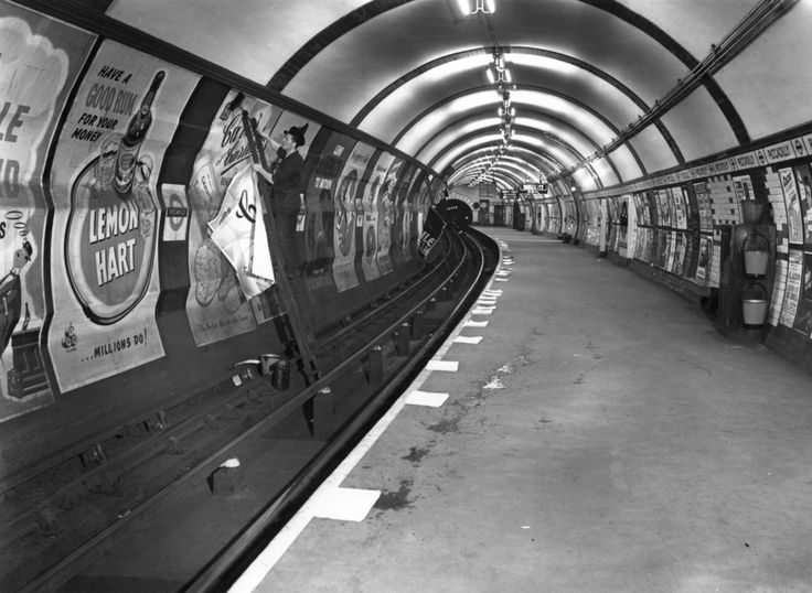 1952: Advertisements being pasted up.   31 Gorgeous Photos Of The London Underground In The '50s And '60s