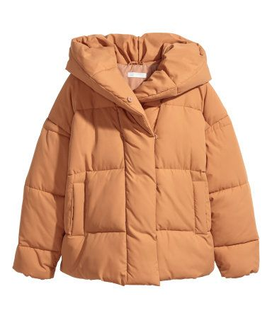 Camel. Oversized, padded jacket in woven fabric with a padded hood. Concealed snap fasteners at front, dropped shoulders, long sleeves, and side pockets.