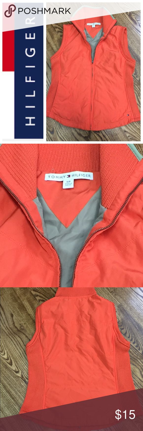 Tommy Hilfiger Orange Vest Fun and chic. This orange vest is like new , lightweight and has a full zip up front and stretch material on he side. Two side sleeve pockets in the front . Check out my closet and save on bundles . Smoke free home. Tommy Hilfiger Jackets & Coats Vests