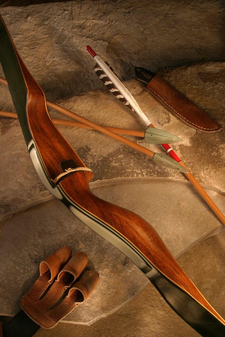 Table Top Photo Of A Vintage Bear Bow Archery Bows