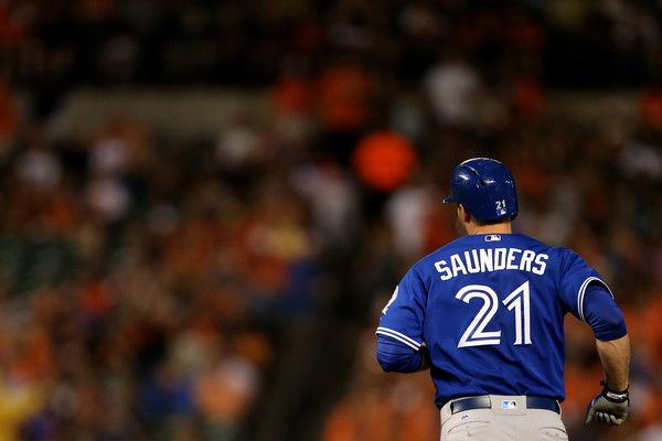 Michael Saunders #21 of the Toronto Blue Jays runs the bases after hitting a two-run home run in the sixth inning against the Baltimore Orioles at Oriole Park at Camden Yards on June 17, 2016 in Baltimore, Maryland.