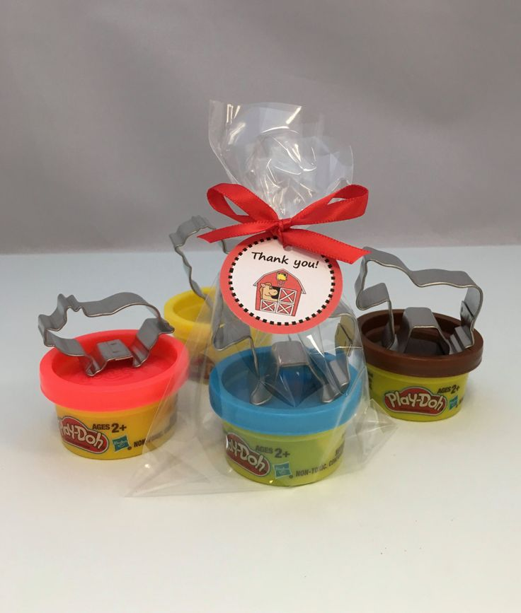 These Western party favors come with a mini container of Play Doh and a metal cutter - either a horse, chicken and/or pig shaped cutter. Presented in a celo bag with a Barnyard themed thank you tag. These are perfect favors for a little boys or little girls barnyard party, animal party or farm party. Please note that you will receive a selection of different colored Play Doh. Take a look at our other barnyard party supplies: https://www.etsy.com/shop/MadHatterPartyB...