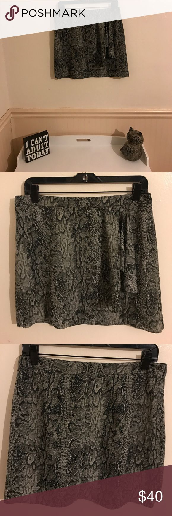 BCBGMaxAzria skirt Grey print reptile skirt. Hits mid thigh. Worn once. Zipper closure. BCBGMaxAzria Skirts Mini