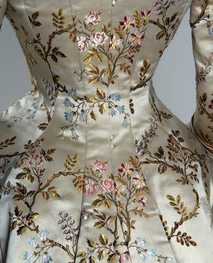 Dinner dress, 1878. Silk brocade, lace, silk satin.