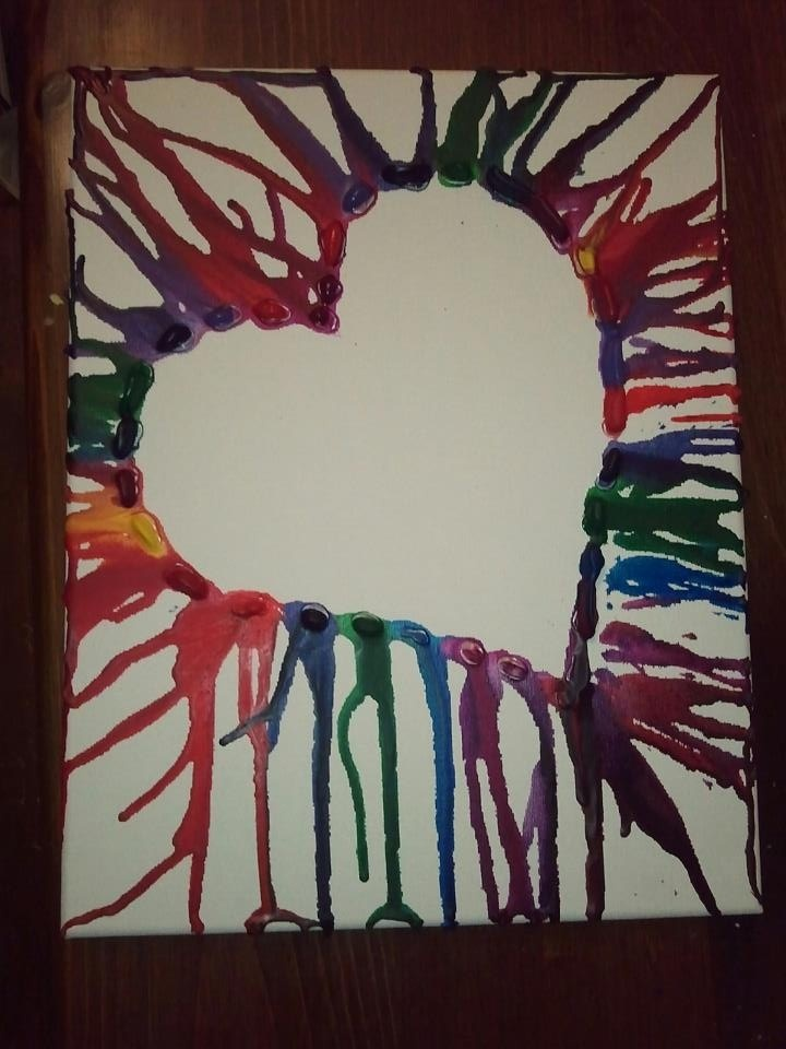 Crayon art!  I made this today for my daughter.  Hot glue crayons in the pattern you want then melt with a hair dryer.