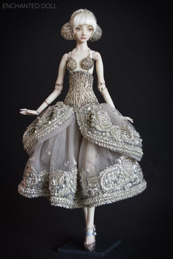 the artist has created everything this doll is wearing. the bun covers and the shoes as well as the dress of course.