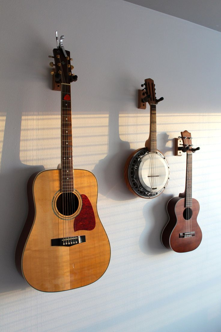 Get those instruments up off the floor! I never thought I'd be the type of person to display a guitar, a banjolin and a ukele on my wall, but now that I've done it I actually think they look quite stylish! Hanging them on the wall keeps them safe from harm and available to play all the time. During my hunt for inexpensive string instrument mounts, I found a handful of gorgeous — mostly handmade — ones that I would love to invest in some day. Take your pick! (Pun intended.)