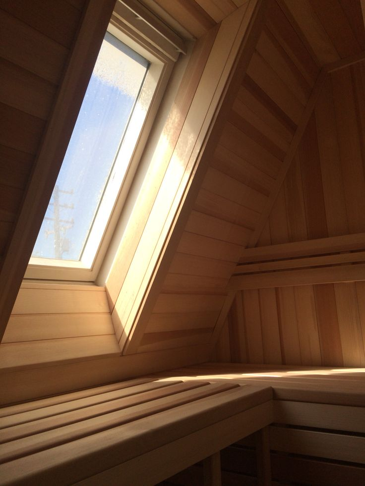 Sauna in an attic with opening skylight