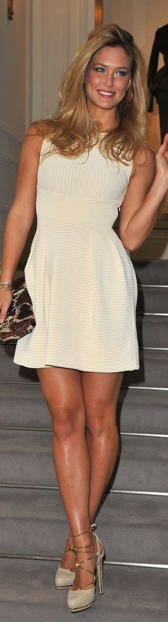 Shapely legs, smooth glowing skin, comfortable smile and femininity is alluring. Bar Refaeli