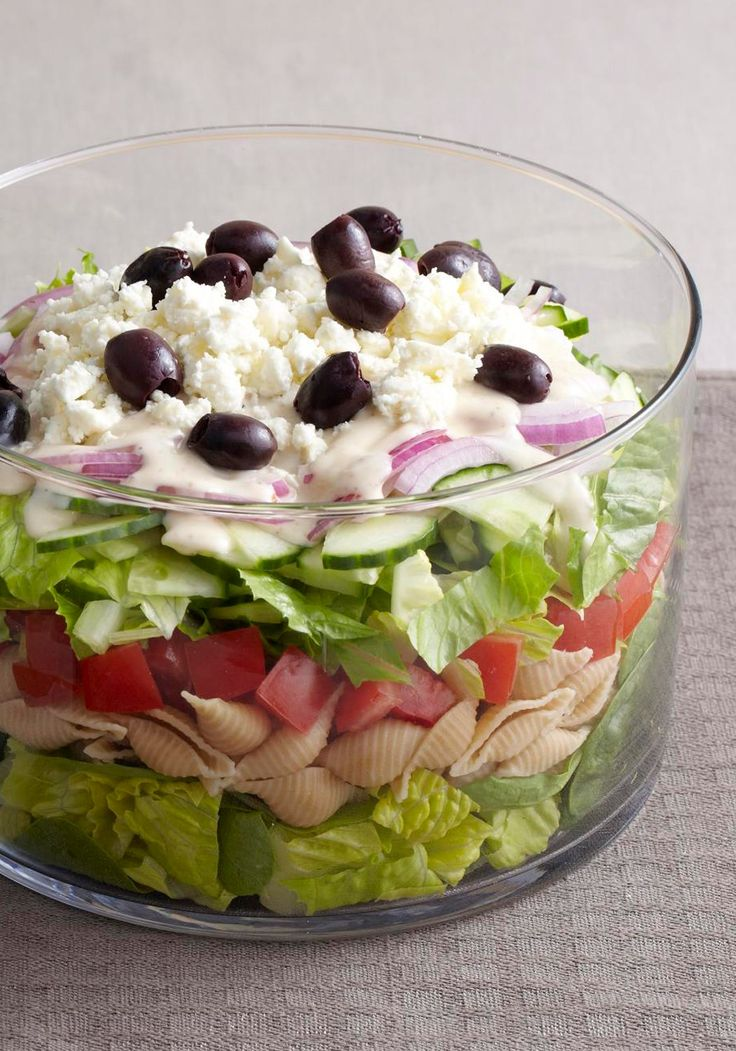 Layered Greek Salad for a Crowd -- This healthy living recipe is ideal for a potluck, where everyone can get a piece of the creamy, cheesy, spinachy, olive-studded action.
