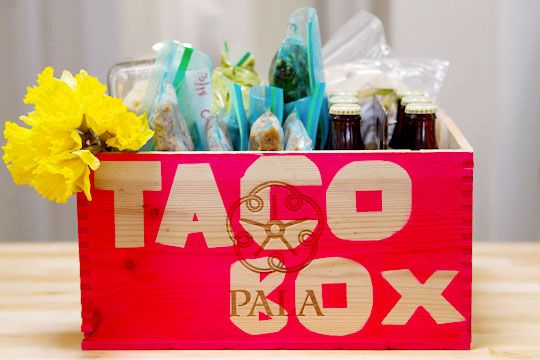 Fill an old wine crate with taco fixings, beer, and fresh flowers! Perfect gift for mama and baby.
