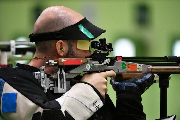 Italy's Niccolo' Campriani competes during the 10m Air Rifle Men's at the Olympic Shooting Centre in Rio de Janeiro on August 8, 2016, during the Rio 2016 Olympic Games.  / AFP / PASCAL GUYOT