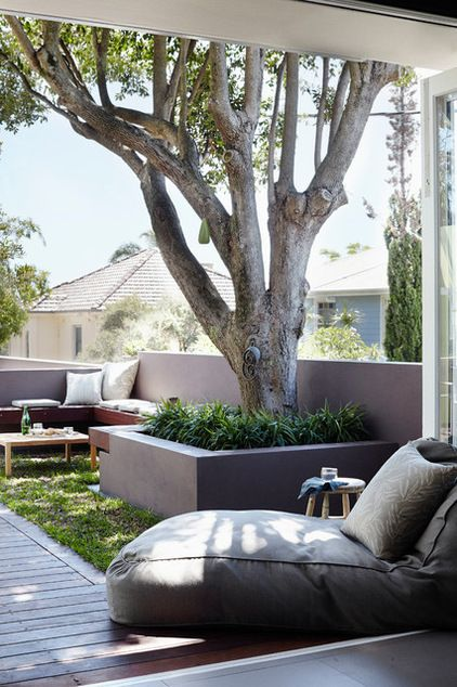 Backyard lounge, small backyard oasis, small backyard space, bring the outdoors in, outdoor seating, shaded backyard, built in seating