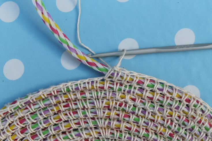 crocheting around rope to make a coiled rug