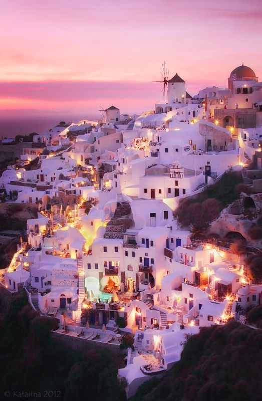 The village of Oia in Santorini, Greece. Santorini curves round a giant lagoon in the Cyclades islands, offering stunning views from sky-high towns, eclectic cuisine, lovely galleries, thriving nightlife and excellent wines.