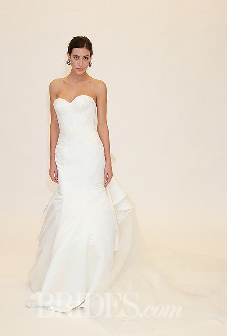 Brides.com: Truly Zac Posen - Spring 2014. Style ZP345004, strapless duchess satin mermaid wedding dress with a sweetheart neckline, geometric seaming, lace applique details, and a cascading train, Truly Zac Posen for David's Bridal