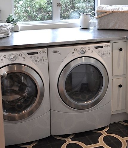 Countertop + Tile Floor.Spaces Laundry Garages Mudroom,  Automatic Washer,  Wash Machine, Stainless Counter, Countertops, Laundry Rooms, Counter Tops, Utility Room, Stainless Steel