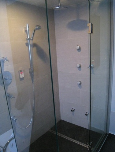 Vancouver steam shower with linear shower drain for Bathroom design ltd