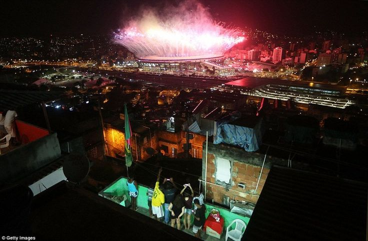 Fans watch on as the #fireworks go off at the #Maracana Stadium during #openingceremony of Rio2016 olympics in #rio2016 in phlow