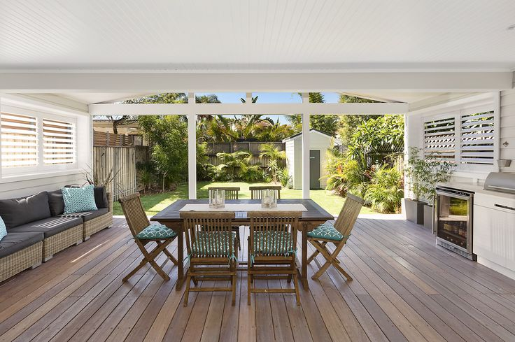 Outdoor deck + kitchen {plantation shutters, planting} | via domain.com.au, 77 Wyuna Avenue, Freshwater #outdoorkitchen