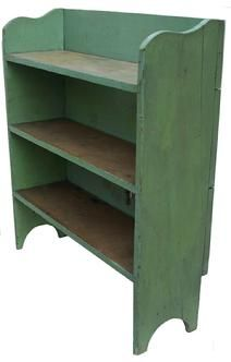 Y340 19th century  Bucket Bench in old apple green paint from Oley Valley Pennslyvania, dovetailed sloted shelves, the back board are held in place with square head nails. Nice high cut out foot.