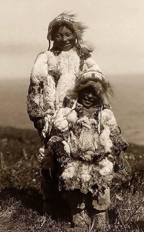 Duck-skin Parkas on Nunivak Eskimo Children. It was created in 1929 by Edward S. Curtis.