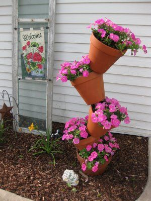 how to make a tipsy flower pot tower. I had a smaller scale version of this a few years ago. It was gorgeous. Need to do this again.