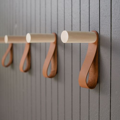 Teddy Hook: Pared down to the most basic elements, the Teddy hook is a natural maple peg hook with a simple leather strap for holding scarves or accessories.