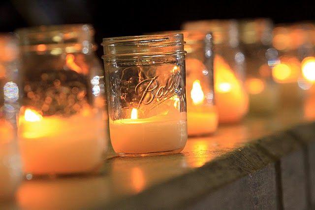 Mrs. Sand Dollar reception decor. Cheap candles melted down inside mason Ball jars #mason #candles #reception