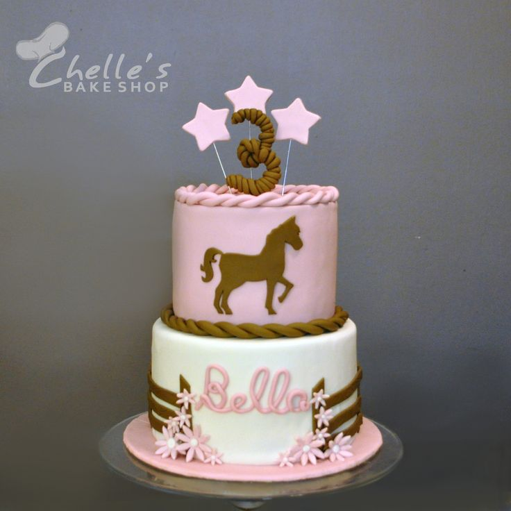 This pink and brown horse cake was for a little girl turning 3. The horse silhouette was cut out of fondant.   www.facebook.com/chellesbakeshop  Oswego, NY