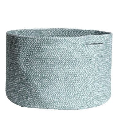 Thick storage basket in melange cotton fabric with two handles. Height 9 in., diameter approx. 13 3/4 in.