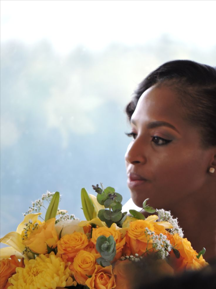 A glimpse of the bride surrounded by flowers