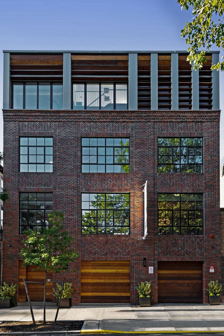 With a nod to Brooklyn's industrial heritage, this brick and walnut facade fits seamlessly in the landscape of this Brooklyn neighborhood.