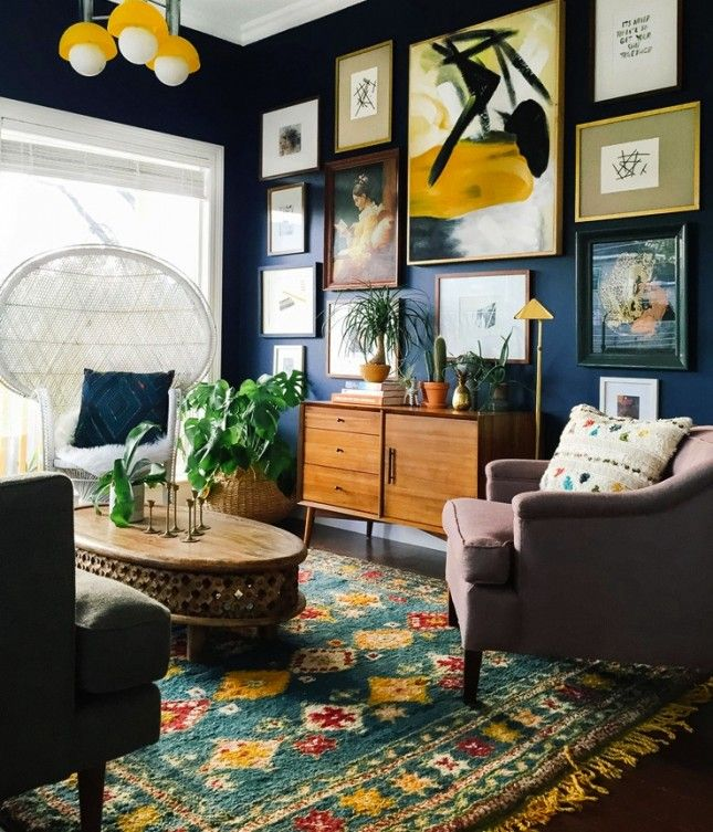 Love this combo of cheery art + colorful textured rugs.