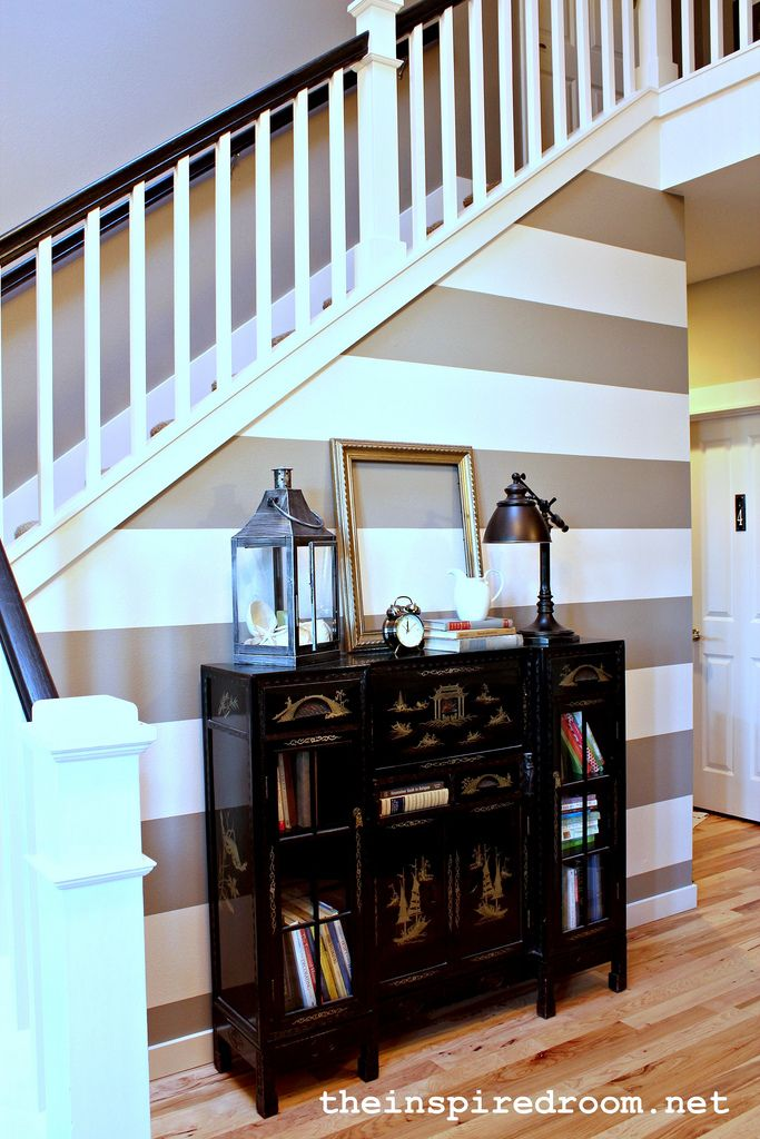 How to paint stripes the secret to crisp stripes for Painting horizontal stripes on walls tips