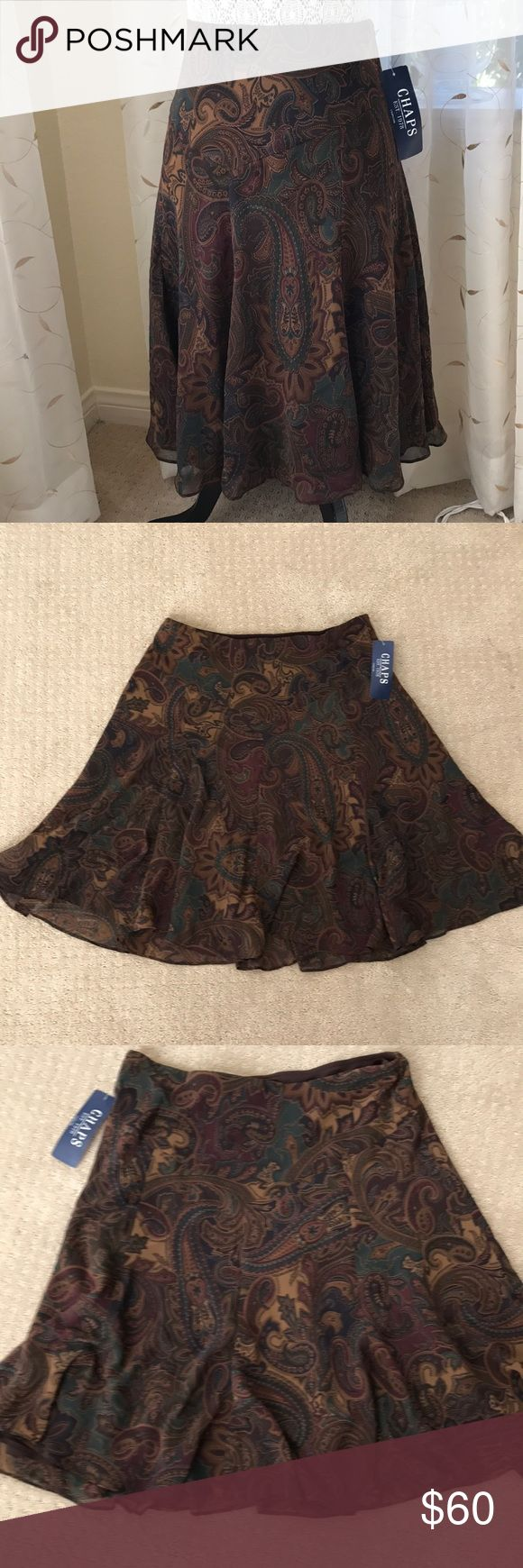 "Chaps ""Oak Street"" brown paisley flared skirt sz M Elegant Chaps ""Oak Street"" brown paisley flared skirt in ladies size medium, brand new with tags. Although the tag states size medium it runs on the large size. I typically wear size 10 & it fits a tad loose. Concealed elasticized waist band measures 16"" across lying flat, length is 24"". This is a gorgeous fully lined  paisley with brown, wine, golden tan, violet & teal. Although delicate in appearance it is well made 100% polyester & can be…"