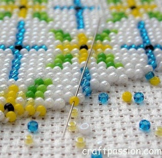 size 15 Japanese seed beads on a 16-count cross-stitch cloth