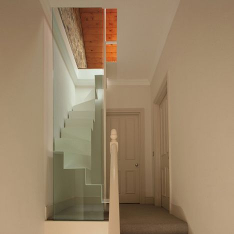 London studio Tamir Addadi Architecture have inserted a tiny staircase to access a tiny loft in a London house.