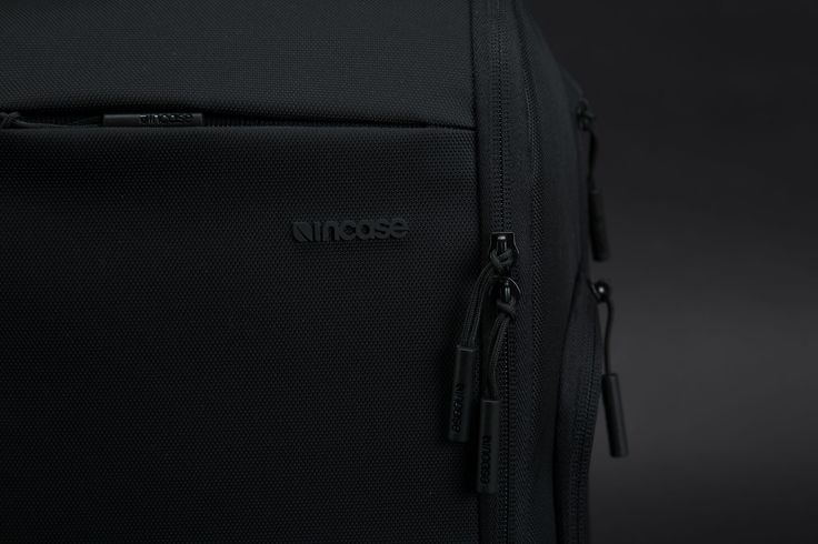 Incase Capture Sling Pack. Half body zip-closure permits effortless access to padded device storage compartment.