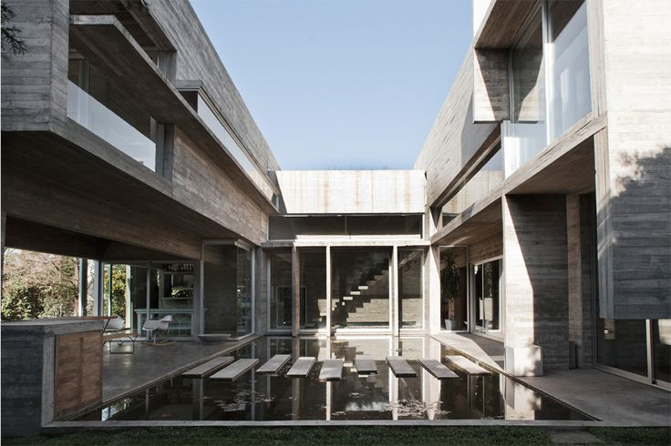 Torcuato House in Buenos Aires, Argentina | division in two volumes | separation between the public and the private | water courtyard  #architecture #interior_design #ek_magazine