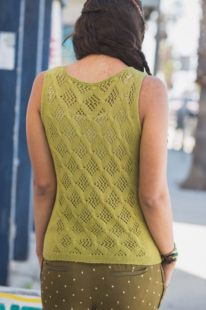 Ventura Tank by Quenna Lee, from Interweave Knits Summer 2016. Designed to be layered or worn alone on the warmest days, the Ventura Tank's A-line silhouette and lace details make it a casual, trendy staple of a summer knitting pattern.