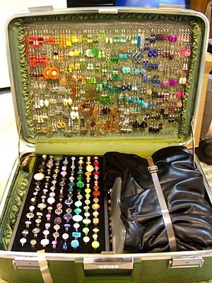Jewelry display in old suitcase.