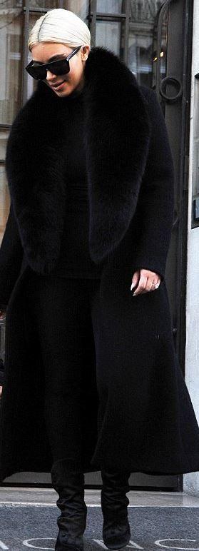 Who made  Kim Kardashian's black sunglasses, velvet boots, and coat?
