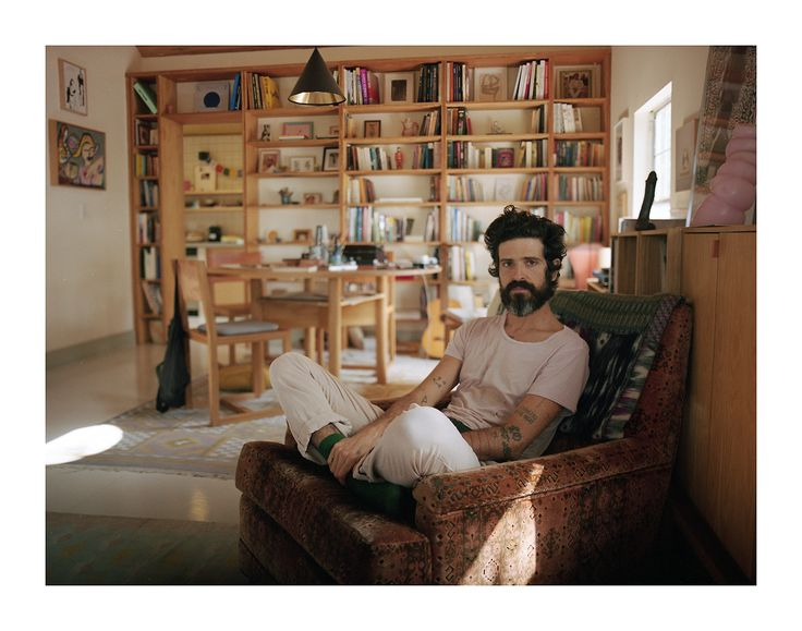 Devendra Banhart sitting on Jim Morrison's chair in his LA home