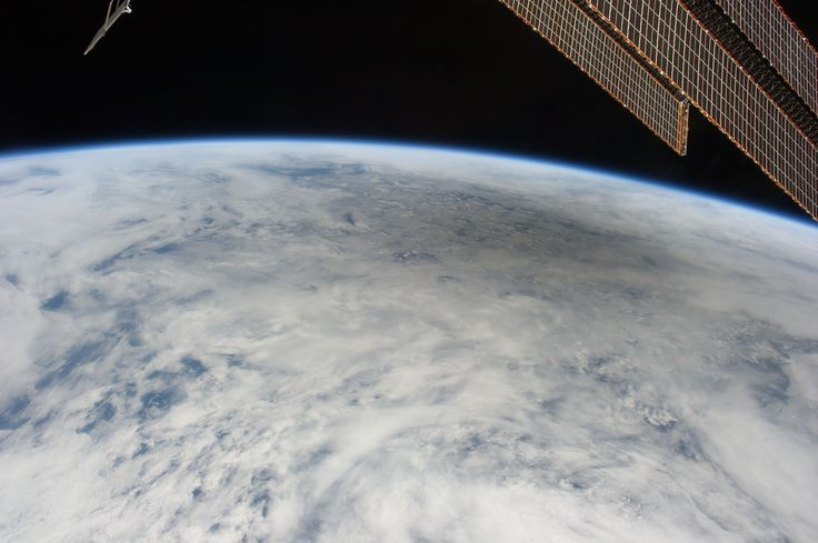 This is one of a series of photos taken by Expedition 31 Flight Engineer Don Pettit aboard the International Space Station, showing a shadow of the moon created by the May 20, 2012 solar eclipse, as the shadow spreads across cloud cover on Earth.