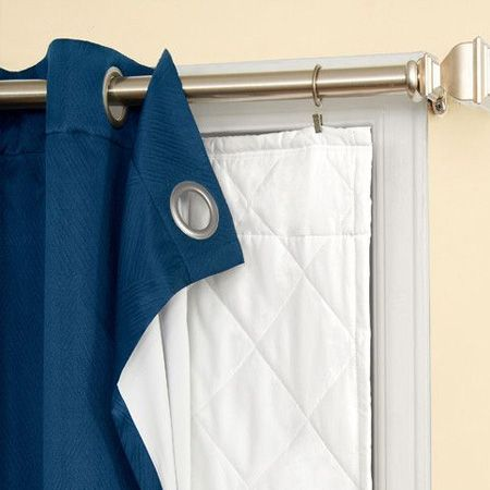 Another temporary option for the colder months of the year is to use curtain clips to hang a thick insulation behind summery curtains.