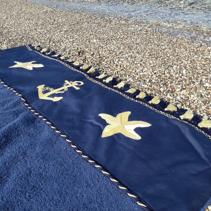 Navy beach towel with handmade embroidery