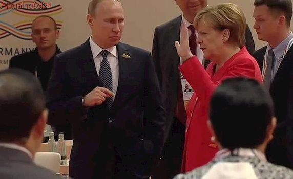 Ten gest Merkel podczas rozmowy z Putinem mógł wiele znaczyć. Kamery zarejestrowały zabawny moment