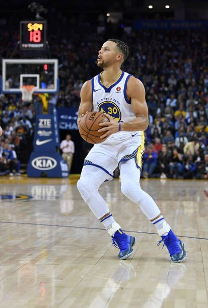 Stephen Curry of the Golden State Warriors looks to shoot the ball against the Philadelphia 76ers during an NBA basketball game at ORACLE Arena on...