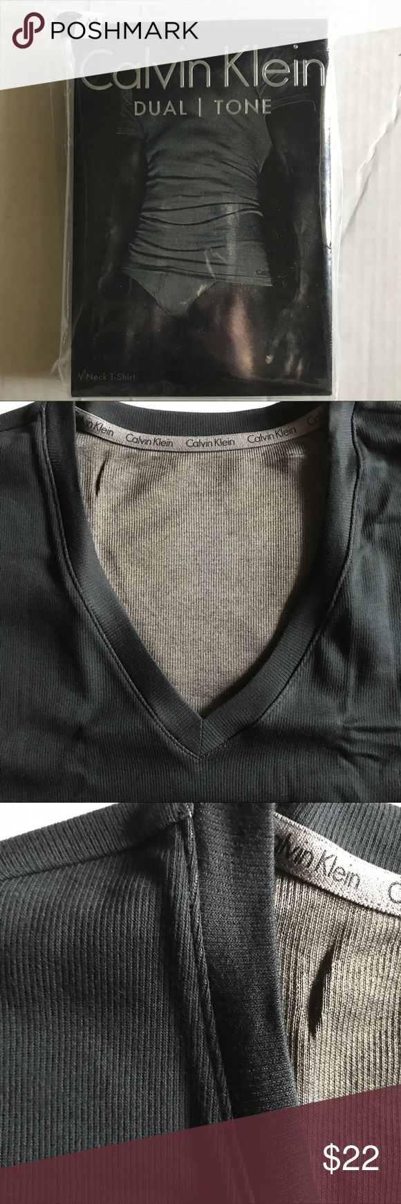 Calvin Klein Duel Tone T-shirt  V-neck S, M, L Calvin Klein's line of Duel Tone Tees. S, M, L men's. Ribbed 2 tones and body defining fit. Stretched will reveal the second undertone; its in the way the fabric is reverse weaved.  One in Black with Brown or one in Steel Blue with Black. Pretty neat. Calvin Klein Underwear Shirts Tees - Short Sleeve